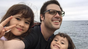 Freelance journalist Scott McIntyre with his two children in Japan.