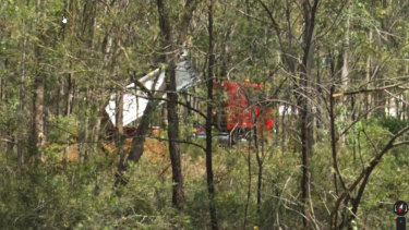 A photograph appears to capture the red truck in the act of dumping.