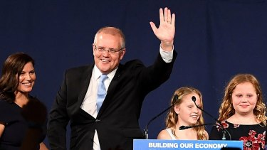 Triumph: Scott Morrison, with wife Jenny and children Lily and Abbey.