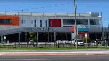 Queensland Health boss Michael Walsh has overturned a directive for ambulances to hold patients outside Logan Hospital until they can be admitted to the emergency department