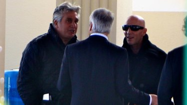 Spink, left, and Stephen Beves, right, at the funeral of underworld figure Norm Beves in 2011.