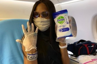 Naomi Campbell and her ever faithful disinfectant wipes as she bravely flies first class during the COVID-19 pandemic.