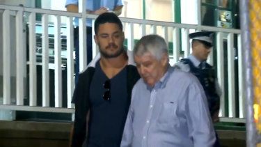Jarryd Hayne leaves Ryde police station with his manager Wayne Beavis.