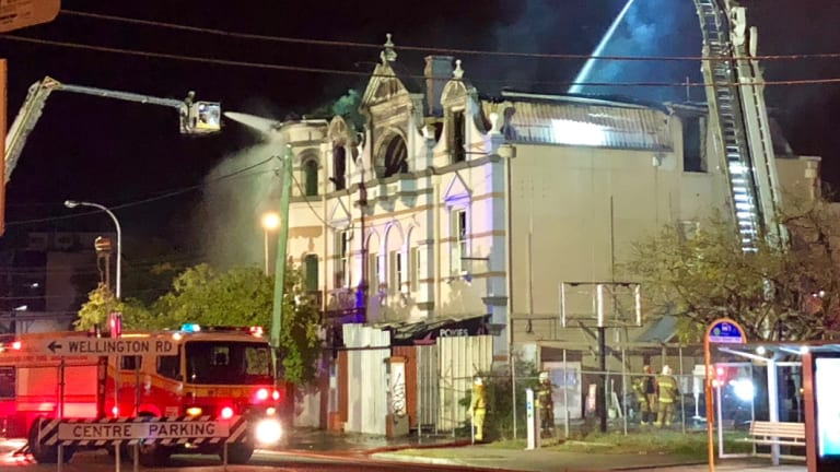 Fire crews brought in aerial appliances to fight the flames that destroyed the hotel in September.