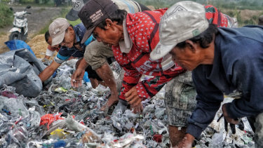 Trash pickers looking for valuable recyclable plastic in East Java this week.