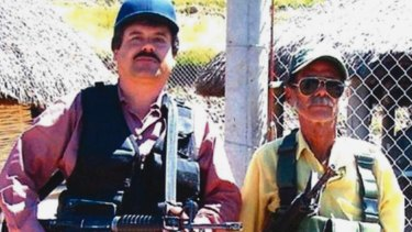 "Joaquin ""El Chapo"" Guzman, left, poses with an unidentified man."
