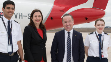 Qantas CEO Alan Joyce and Queensland Premier Annastacia Palaszczuk with two student pilots, Baha'a Fayoumi and Inez Leggett at Toowoomba in Queensland on Thursday.