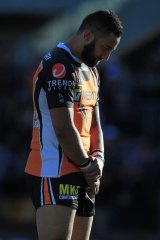Remembrance: Tigers' Benji Marshall stands in a minutes silence for Robbie Farah's mother.