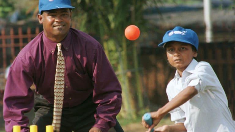 Batsman Vinod Kambli with a young protege.