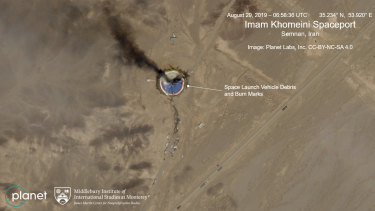 The satellite image shows the smoldering remains of a rocket at a Iran space centre.