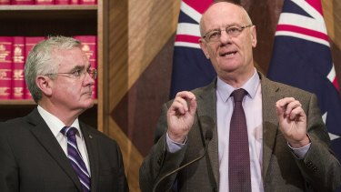 From left, Andrew Wilkie, Reverend Tim Costello of the Alliance for Gambling Reform.