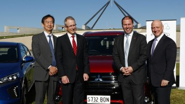 Mitsubishi chief executive Mutsuhito Oshikiri, Minister for Urban Infrastructure Paul Fletcher, then-minister for Environment and Energy Josh Frydenberg and then-AGL chief executive Andy Vesy at an electric car event in 2017.