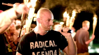 Crypto-currencies are a favourite of the alt-right. Here a white nationalist stands at a rally in Charlottesville, Virginia in 2017.