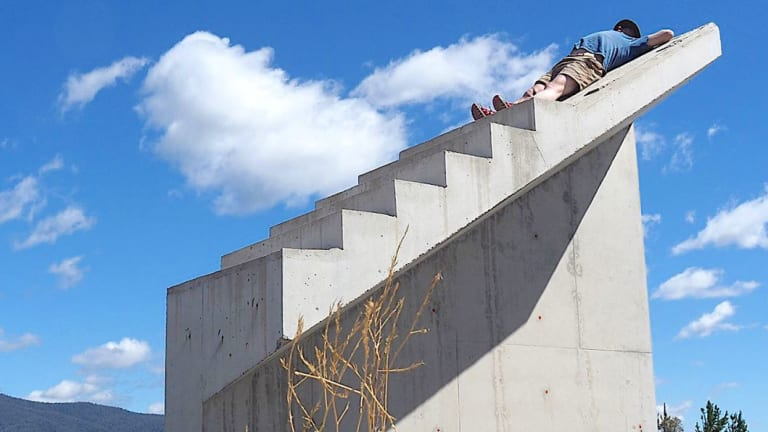 Thomas Schulze takes a nap on the Cotter's infamous stairs to nowhere.