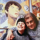 Artists Pat and Richard Larter in front of one of his portraits of her.