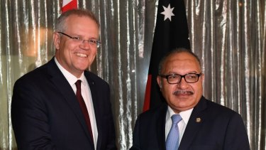 Prime Minister Scott Morrison greets Prime Minister of Papua New Guinea Peter O'Neill ahead of talks on defence and law enforcement in Sydney, last year.