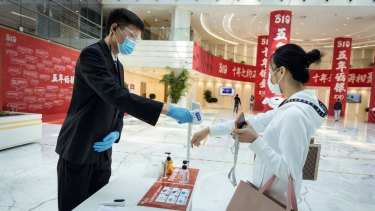 At e-commerce giant JD.com's headquarters in Beijing, employees have their temperature screened and the building is disinfected three times a day.