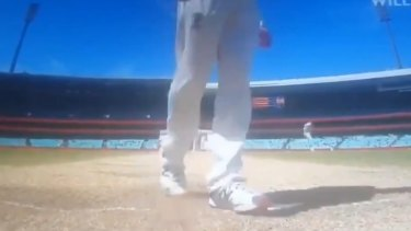 Steve Smith scuffs the pitch, obscuring Rishabh Pant's guard mark.
