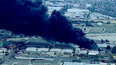 The warehouse fire sent plumes of black smoke across Melbourne's western suburbs.