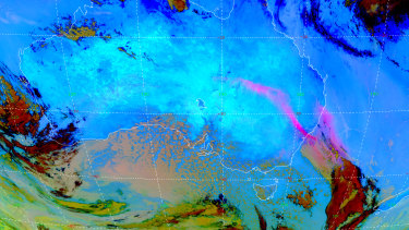 This satellite image from 11.20am on Wednesday shows the dust cloud (in pink) stretching from south-west Queensland, through NSW and into the Tasman Sea.