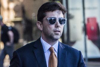 AFR columnist Joe Aston leaves the Federal Court on Monday.
