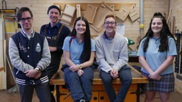 Dean Maddock (second left) with students at his timber workshop at Jamison High School.