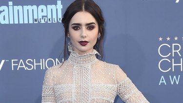 Lily Collins rocks a rich burgundy lip.
