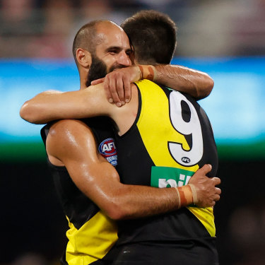 Bachar Houli and Trent Cotchin, his friend and captain, celebrate the 2020 grand final victory.