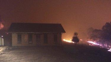 The fires edging towards Richard Glover's bush house.