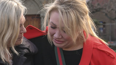 Parents Janet Mitchell, left, and Sam Baker react with sadness to news of the school's coming closure.
