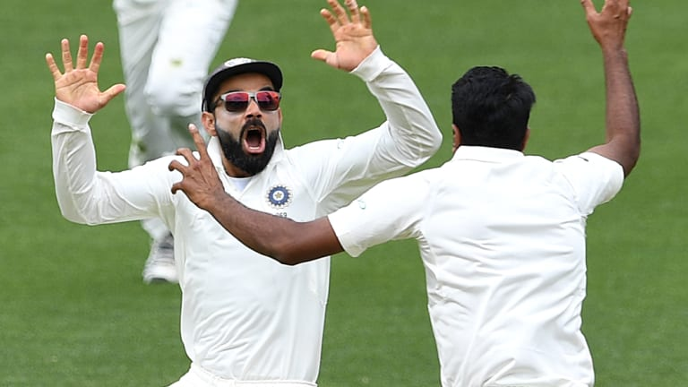 First blood: Virat Kohli, left, celebrates after defeating Australia by 31 runs in Adelaide.