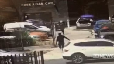 CCTV footage of gunmen at the Epping panel beater shop owned by Ali El Nasher.