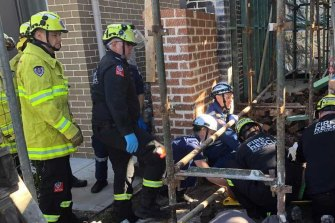 One man was trapped under rubble for around 30 minutes until he was extricated by Fire and Rescue NSW.