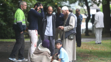 Stunned and bloodied workshippers outside one of the Christchurch mosques.