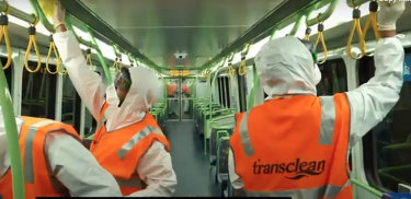 Transclean staff cleaning a Metro train carriage during the COVID-19 pandemic.