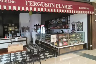 People in hazmat suits give the Ferguson Plarre bakery at the Chadstone shopping centre a deep clean after an employee who worked in the store on Wednesday tested positive for COVID-19.