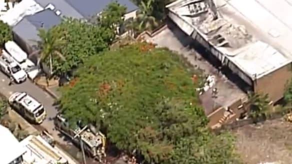 Unit block fire covers Brisbane university campus in black smoke