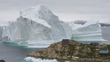 A massive iceberg caused the evacuation of the Greenland village of Innarsuit.