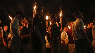Multiple white nationalist groups march with torches through the University of Virginia.