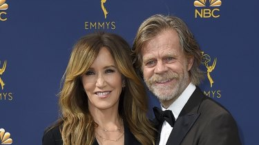 Felicity Huffman, left, and William H. Macy arrive at the 70th Primetime Emmy Awards in Los Angeles in September.