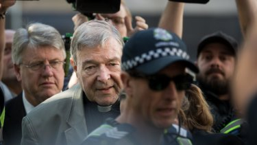 Cardinal George Pell arrives at the Melbourne County Court on Wednesday.