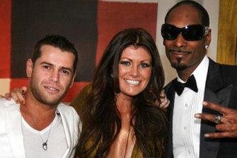 Eugeni 'Zhenya' Tsvetnenko and Lydia Tsvetnenko, who is not accused of any crime, party with rapper Snoop Dogg.