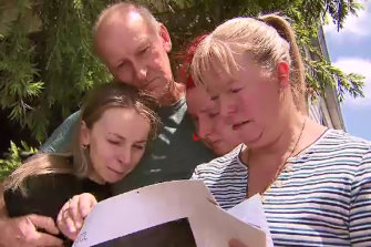 Cameron Smith's sister Taylah (left); father, Michael; sister Chantelle; and mother, Michelle, after his death last year.