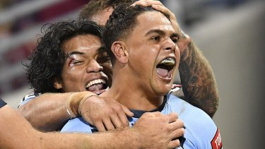 Latrell Mitchell celebrates his first try in a stirring comeback for NSW.