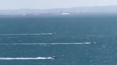 Search vessels swept Moreton Bay in formation.
