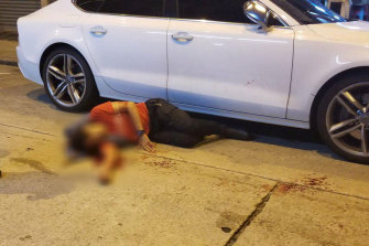 Jimmy Sham lies on the road after being attacked by a group of up to five men.