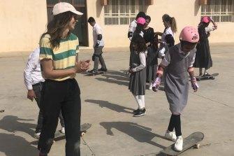 Kirby Clark teaching skateboarding in Iraq.