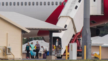 Australian evacuees from Diamond Princess arrive in Darwin on Thursday.