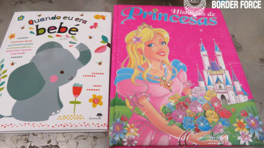 A man has been charged after allegedly importing 1.72kg of cocaine in children's books.