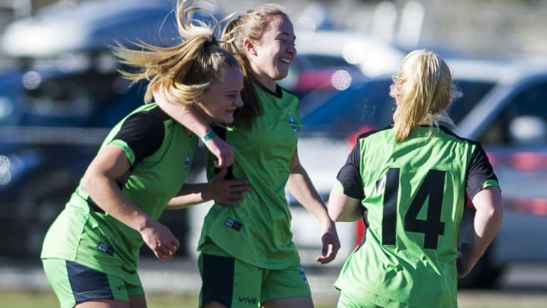 Hayley Taylor Young celebrates with her team after scoring a goal.